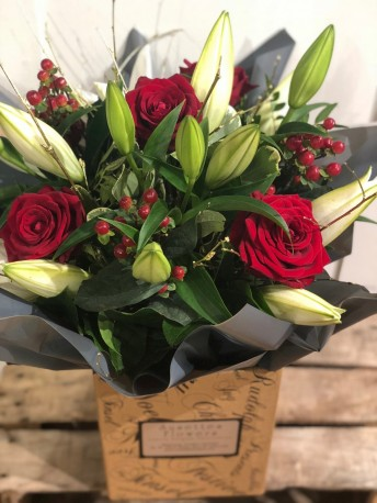 Festive rose and lily bouquet